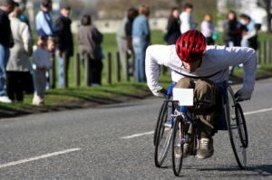 A person in a wheelchair is racing on a track.