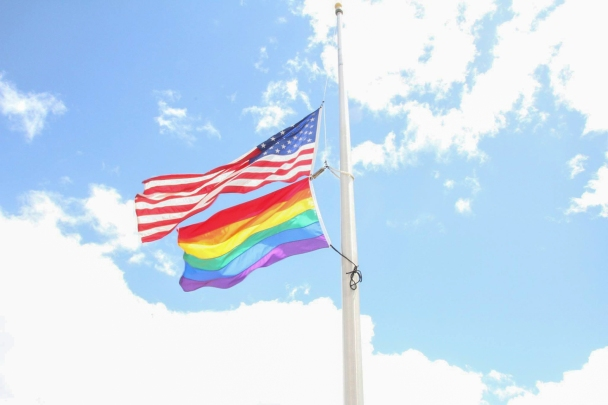 U.S. and rainbow flags at half-mast at the U.S. embassy in Kingston, Jamaica, June 14, 2016.