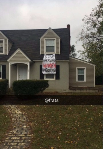 "picture of a house depicting a sign that says ""stop harassing women #godukes"""