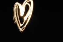 light streaked heart black background