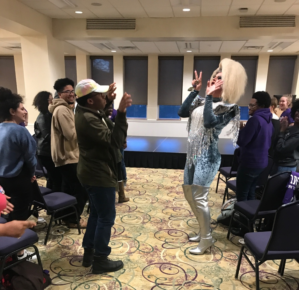 "Local drag queen, Genesis, dancing with a crowd member at ""I, Too, Am JMU"""