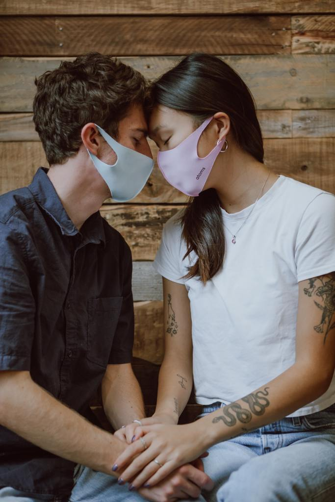 Two people wearing masks, who are trying to connect and bond with one another.