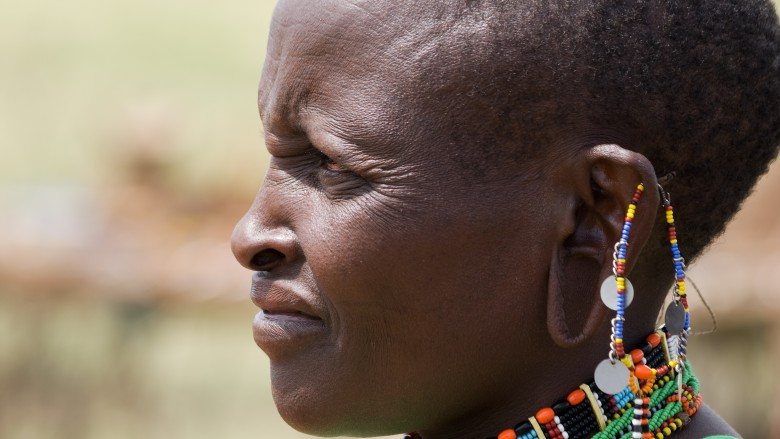 A woman of the Masai tribe with large, stretched earlobes and a shaved head